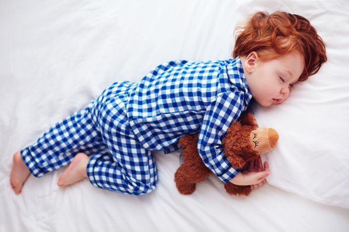 Toddler in bed sleeping